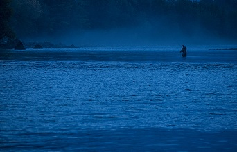 flyfishing in the fog at Adige river , Vallagarina, Trentino, Italy, Europe