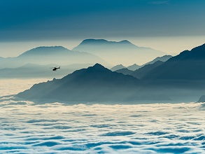 Elicopter above the fog on the Valle dei Laghi valley from Bondone mountain, Trentino, Italy, Europe