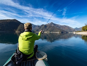 fishing spinning from the kayak  Ledro lake, val di Ledro, Trentino, Italy, Europe