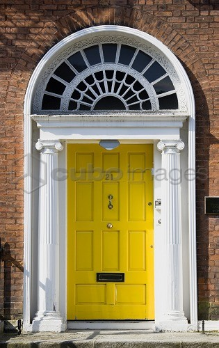 Ireland, County Dublin, Dublin City, Yellow Georgian door in the city centre south of the Liffey River.