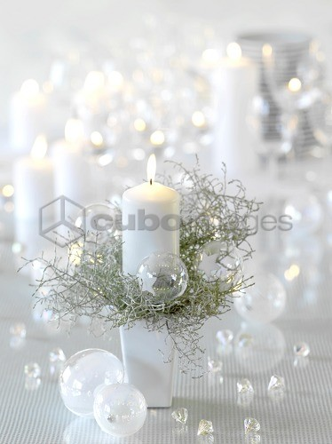 Still: Decorated Christmas table with burning candle