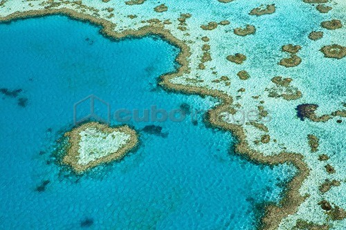 Australia, Queensland, Whitsundays, Great Barrier Reef Marine Park.  Aerial view of 'Heart Reef', a heart-shaped coral formation at Hardys Reef.