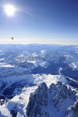 Hot-air balloon flying above Dolomites with Langkofel and Plattkofel in foreground, Sella range, Marmolada range and Pala range in background, aerial photo, Dolomites, South Tyrol, Italy, Europe