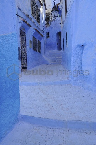 Blue walls and doors in a narrow alley at Chefchaouen, Riff mountains, Morocco, Africa