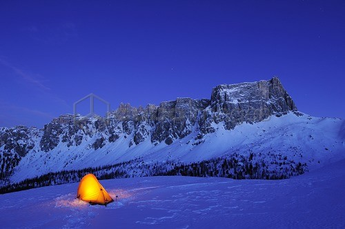 Illuminated tent on snow face in front of Croda da Lago and Monte Formin, Passo Giau, Cortina d' Ampezzo, UNESCO World Heritage Site Dolomites, Dolomites, Venetia, Italy, Europe