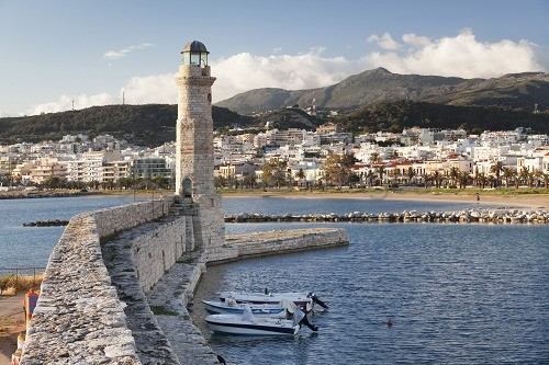 Lighthouse at old Venetian harbour, Rethymno (Rethymnon), Crete, Greek Islands, Greece, Europe