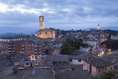 The rooftops of Perugia with the Basilica di San Pietro and Basilica di San Domencio in the background, Perugia, Umbria, Italy, Europe