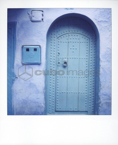 Polaroid of traditional painted blue door against bluewashed wall, Chefchaouen, Morocco, North Africa, Africa