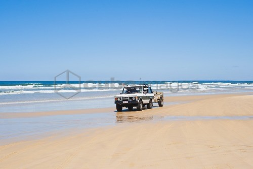 Tourists driving on Seventy Five Mile Beach on a self drive 4x4 tour of Fraser Island, UNESCO World Heritage Site, Queensland, Australia, Pacific
