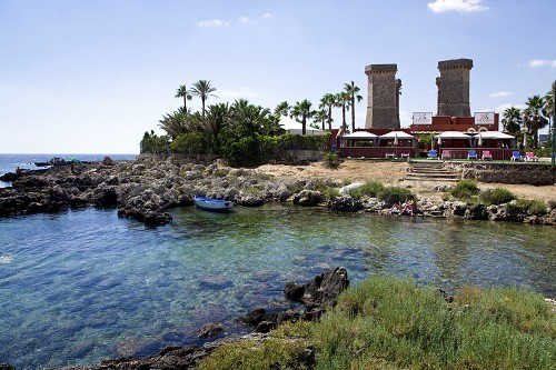 Seaside, in the background Quattro colonne tower, Santa Maria al ...