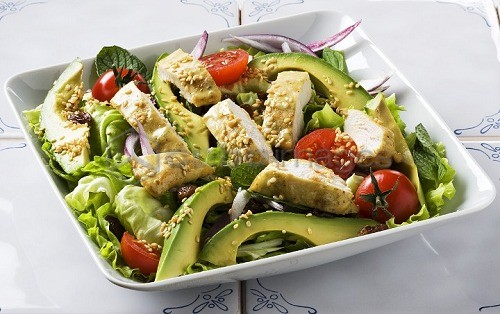 Chicken salad with avocados and sesame seeds