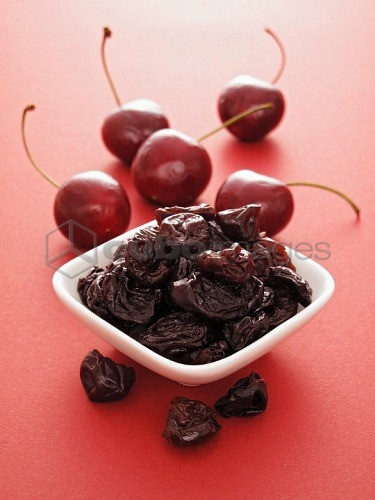 Fresh cherries and dried cherries in a bowl