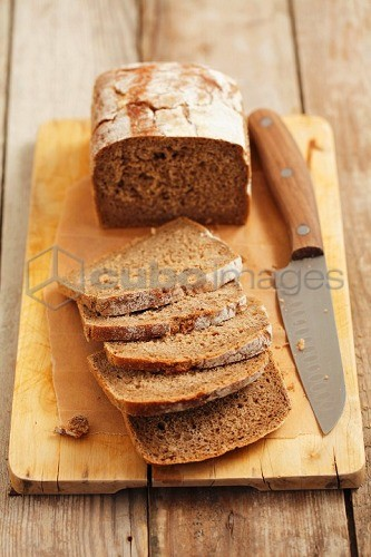 Wholemeal bread, sliced on a chopping board