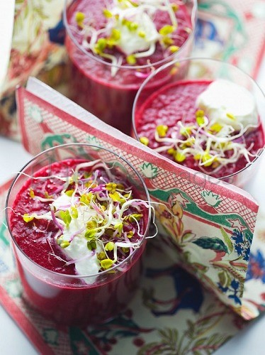 Beetroot juice garnished with shoots and sour cream