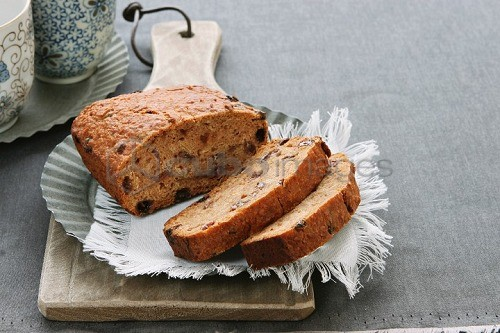 Home-made fruit loaf, partly sliced