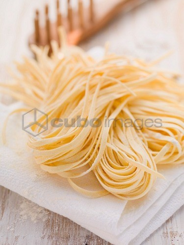 Home-made ribbon pasta on kitchen roll
