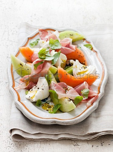 Melon salad with ham and egg