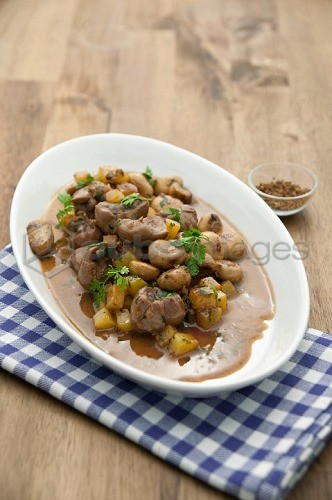 Veal with mushrooms and roast potatoes