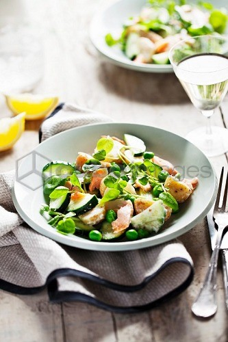 Salmon salad with peas and cucumber