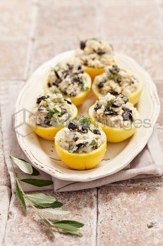 Lemons stuffed with cod and olives