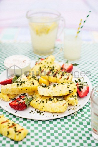 Grilled pineapple with strawberries and mint sugar