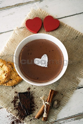 Chocolate pudding decorated with a icing sugar heart