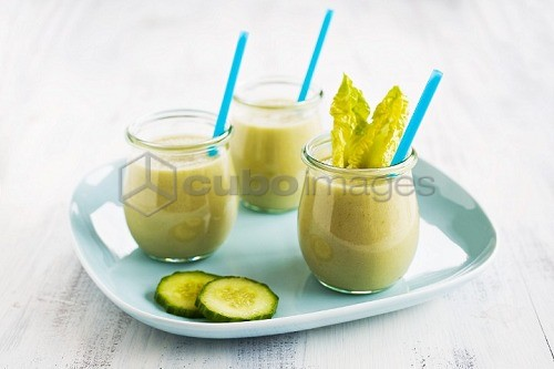 Vegetable smoothies in glasses with straws