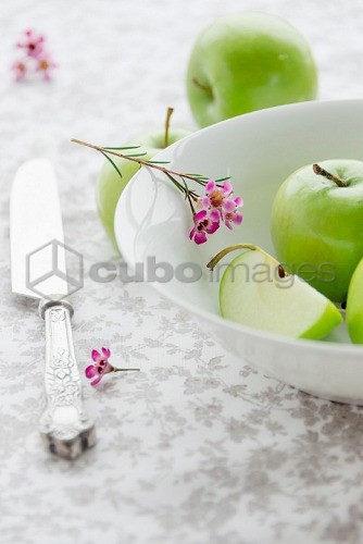 Granny Smith apples with pink flowers