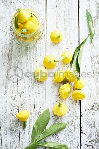 Yellow patty pan squash on a wooden table