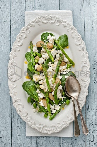 Asparagus salad with feta cheese, new potatoes and spinach (seen from above)