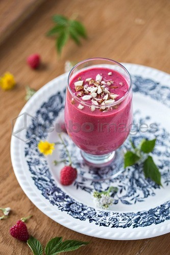 A raspberry smoothie with almonds