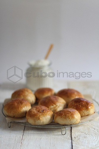 Bread rolls on a cooling rack